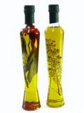 Aceite de oliva con las hierbas Imagenes de archivo