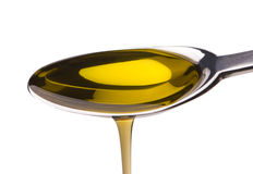 Aceite de oliva en una cuchara Imagen de archivo libre de regalías