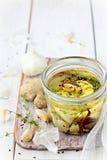 Aceite de oliva infundido Fotos de archivo libres de regalías