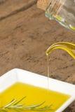 Aceite y romero de oliva de la Virgen Foto de archivo libre de regalías