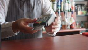 Aceptar el pago del ` s del cliente con la tarjeta de crédito almacen de video