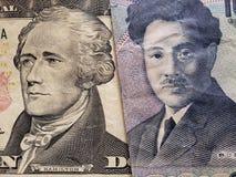 acercamiento al billete de banco americano de diez dólares y al billete de banco japonés de 1000 yenes fotografía de archivo libre de regalías