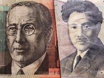 acercamiento al billete de banco australiano de veinte dólares y al billete de banco japonés de 1000 yenes fotografía de archivo