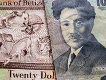 acercamiento al billete de banco beliceño de veinte dólares y al billete de banco japonés de 1000 yenes fotografía de archivo libre de regalías