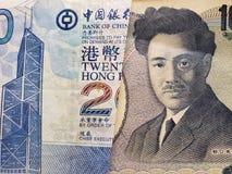 acercamiento al billete de banco de Hong Kong de veinte dólares y al billete de banco japonés de 1000 yenes imágenes de archivo libres de regalías