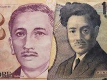 acercamiento al billete de banco singapurense de dos dólares y al billete de banco japonés de 1000 yenes imagen de archivo libre de regalías