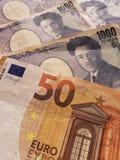 acercamiento al euro europeo del billete de banco cincuenta y al billete de banco japonés de 1000 yenes fotos de archivo libres de regalías