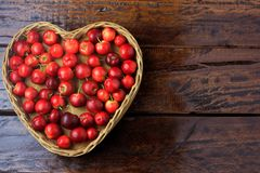 Free Acerola Cherry Raw, Fresh, In Basket With Heart Shape On Rustic Wooden Table, Antioxidant Fruits Stock Photography - 135533012