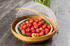 Acerola cherry on wood table. The Acerola cherry on wood table Royalty Free Stock Photo