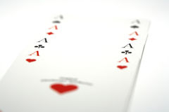Aces. 4 acces and a white background Royalty Free Stock Photos