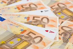 Aces Between Euro Bills Royalty Free Stock Photos