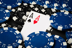 Aces covered with chips Royalty Free Stock Photos