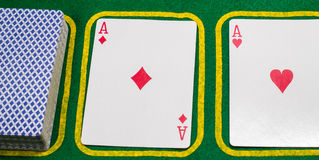 Aces and a deck on a green cloth Royalty Free Stock Photos
