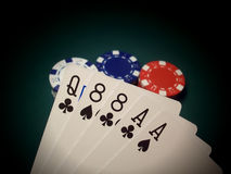 Aces And Eights The Dead Man's Hand. Red, blue, and white poker chips on a green felt table are highlighted. The poker hand displayed is a pair of Aces and a Royalty Free Stock Photos