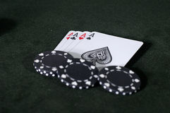 Aces - Four of a Kind. Four of a Kind aces, and some black poker chips Stock Images