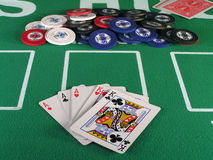 Aces Full of Kings. Full house in a hand of poker with chips on a green felt table Royalty Free Stock Photos