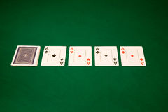 Aces on a green table. Four of a kind Aces in Las Vegas casino on the green table stock images