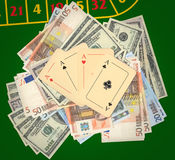 Aces on a heap of money Stock Image