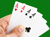 Aces. Man hand holding four aces on green background with clipping path Royalty Free Stock Image