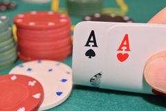 Aces pair on a gambling table. With chips royalty free stock images