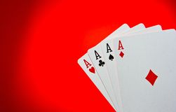 Aces Poker. Four aces poker on red background Royalty Free Stock Images