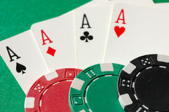Aces and Poker Chips. Four aces and poker chips representing a winning hand Stock Photos