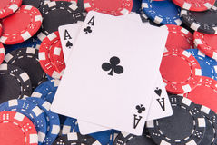 Aces poker and chips. Black aces poker and chips center close up Stock Photography