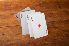 Aces on a wood background Royalty Free Stock Images