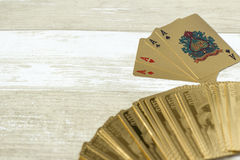 Aces on a wooden background. Gold aces cards on a wooden background Stock Images