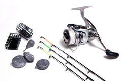 Acessórios da pesca no fundo branco Fotografia de Stock Royalty Free