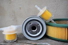 Acessórios das peças de automóvel: filtro do óleo, do combustível ou de ar para o carro do motor fotografia de stock royalty free
