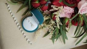 Acessórios do casamento Anéis e joia filme