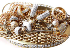 Acessórios dourados ricos isolados Imagem de Stock