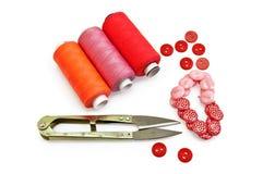 Acessórios Sewing vermelhos Imagens de Stock Royalty Free