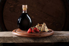 Aceto balsamico di Modena. Modena balsamic vinegar with strawberries and Parmesan stock images