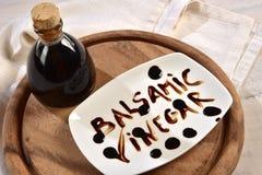 Aceto-balsamico e scritta Stockfotografie
