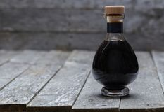 Aceto balsamico on old gray wood Stock Images