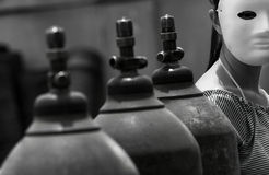 Acetylene bottles and masked female-Black and white Stock Image