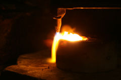 Acetylene torch smelting hot precious metals down Royalty Free Stock Photo