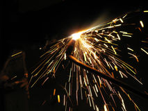 Acetylene Welding I. Acetylene welding torch in action, black background stock image