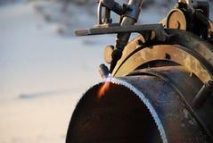 Acetylenfackel und Eisenrohr Stockbild