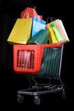 achat de cadeaux de chariot noir de fond plein Photo libre de droits