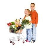 achat sain de gosses de nourriture Photographie stock libre de droits