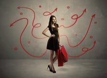 Achats élégants de femme et flèches rouges Image stock