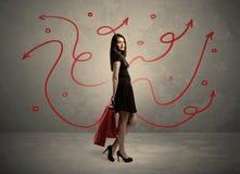 Achats élégants de femme et flèches rouges Images libres de droits