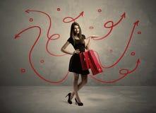 Achats élégants de femme et flèches rouges Photos libres de droits