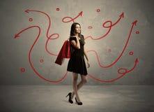Achats élégants de femme et flèches rouges Photo libre de droits