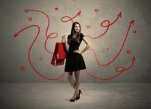 Achats élégants de femme et flèches rouges Photographie stock libre de droits