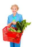 achats aînés de dame d'épicerie Images stock
