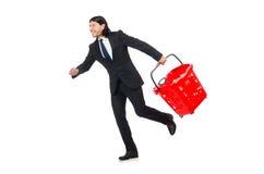 Achats d'homme avec le chariot de panier de supermarché Photos libres de droits